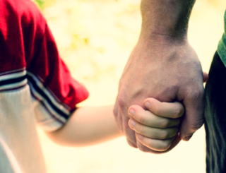 Dad-and-son-holding-hands
